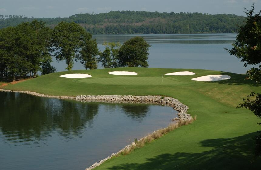 golf course with lake in the background