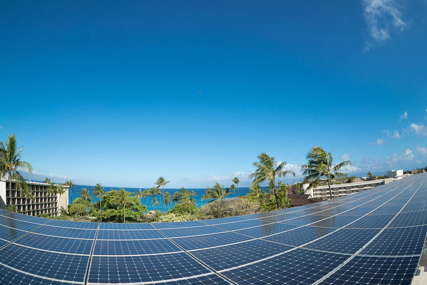solar energy plates next to ocean