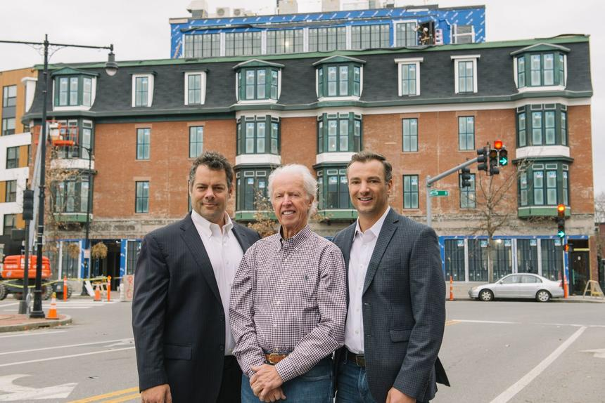 Owners posing outside 907 Main