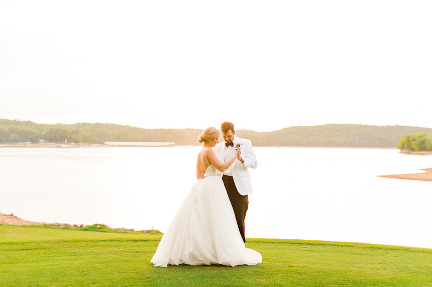 bride and groom dancing on golf course