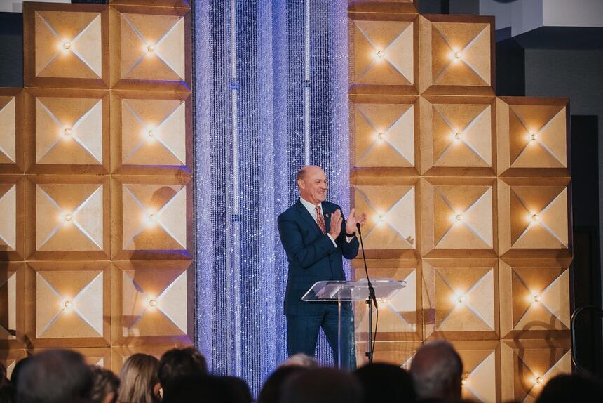 man speaking at banquet