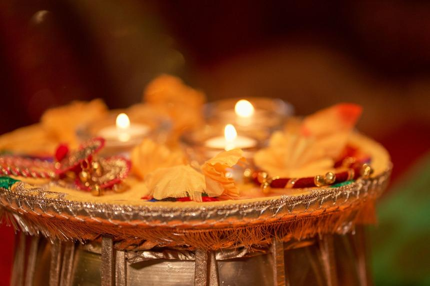 small table with south asian décor pieces and tea candles