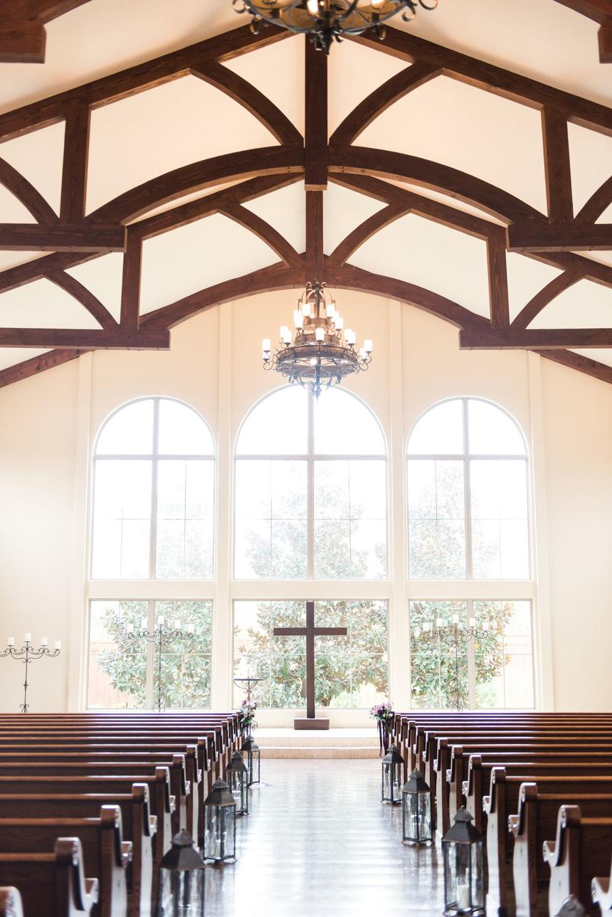 chapel with windows behind altar and pews