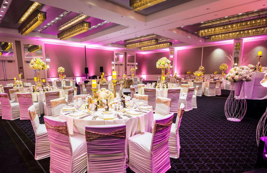 a ballroom with pink lights