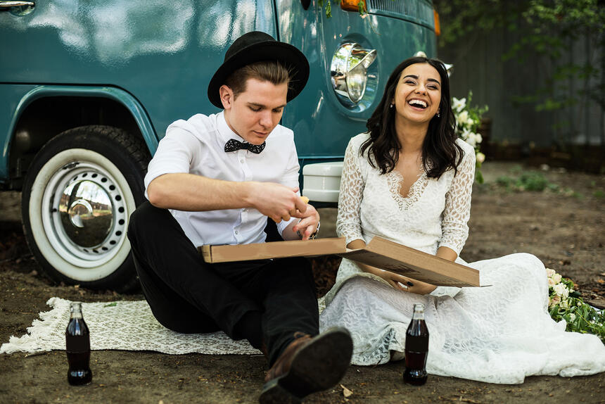 a bride and groom having a picnic