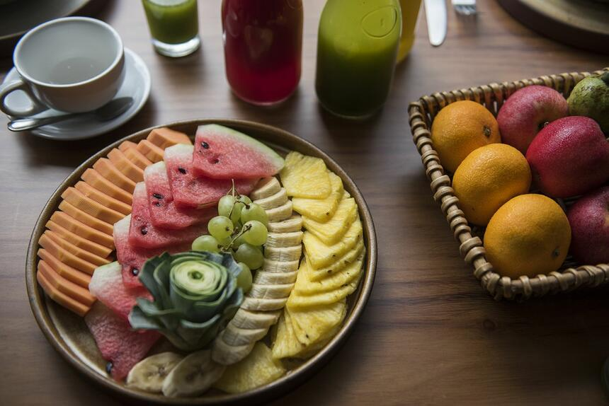plate of assorted fruit on dining table