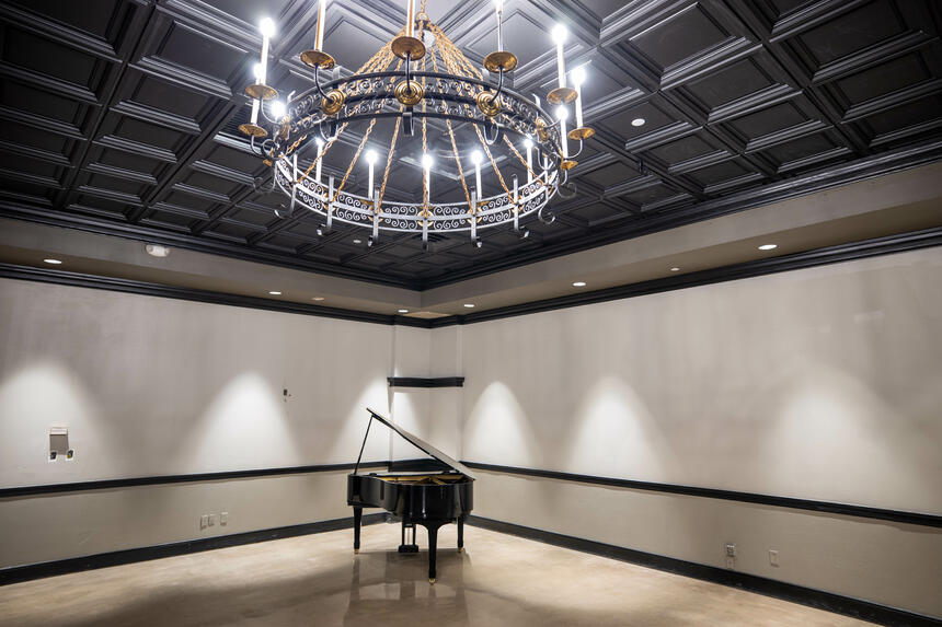 a piano in a ballroom