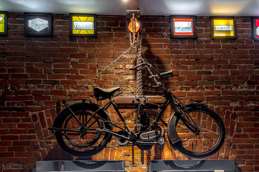 a bike hanging on a wall