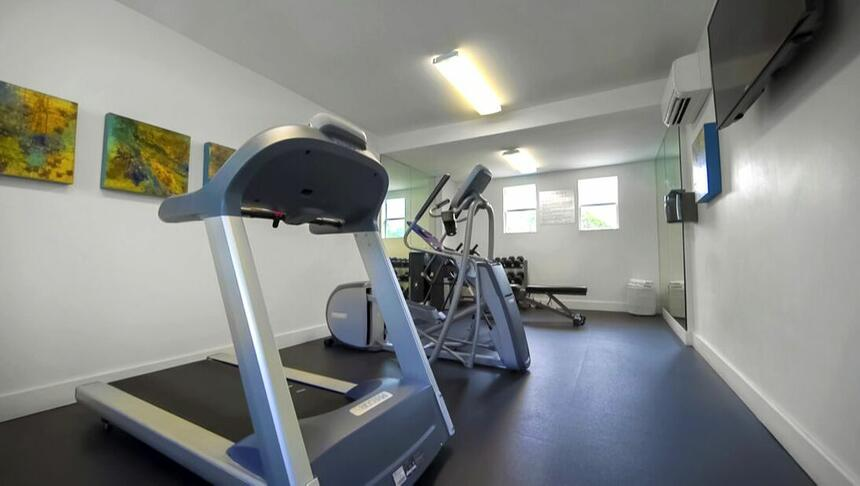 Gym that includes an Elliptical machine, a treadmill, a bike and