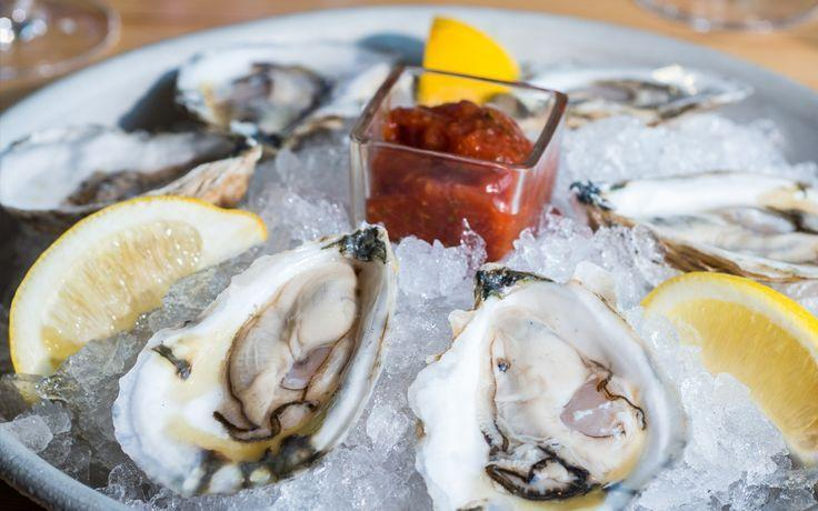 Shucked oysters with cocktail sauce