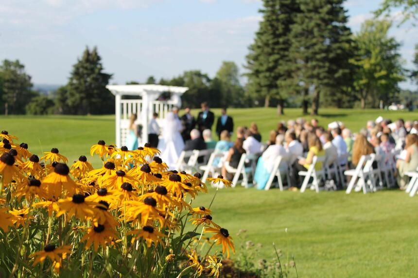 outdoor wedding ceremony with guests