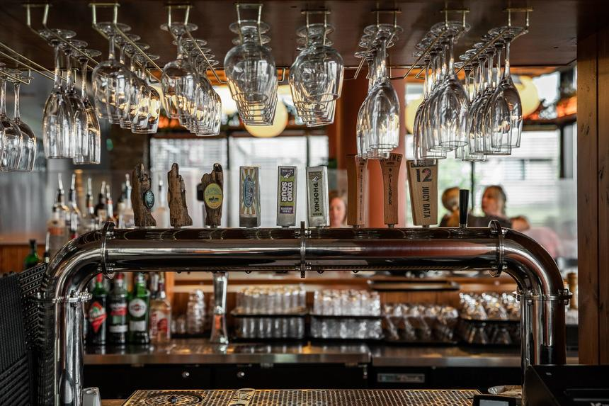 drinking glasses hanging above a bar