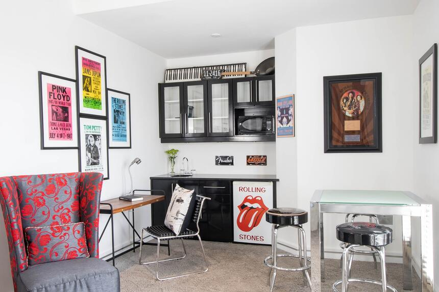 rock n roll memorabilia and art, kitchenette and table with chai