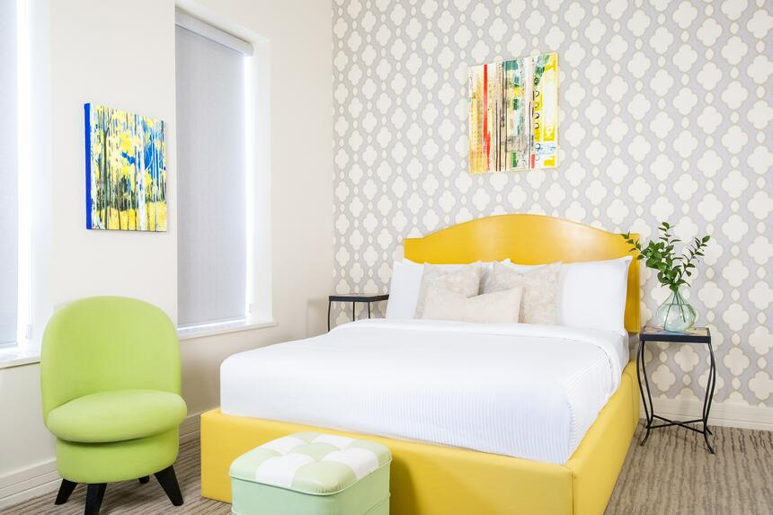 queen bed in sunset suits with a bright yellow bed frame