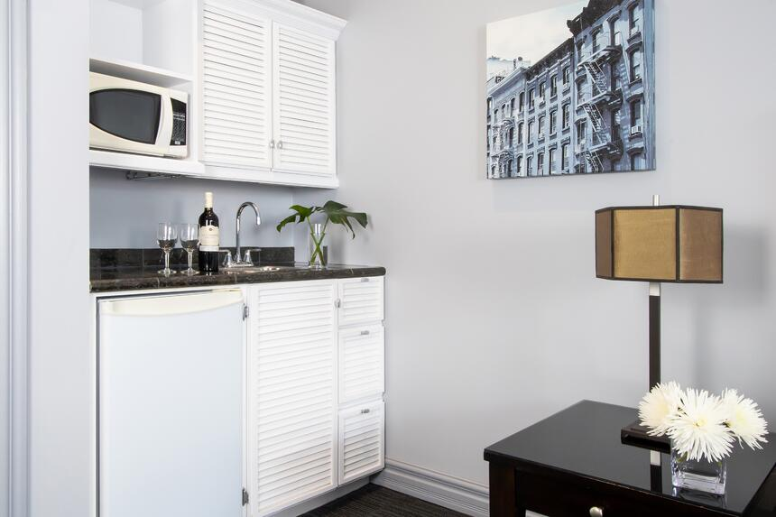 kitchenette in manhattan with mini fridge, microwave, sink and c