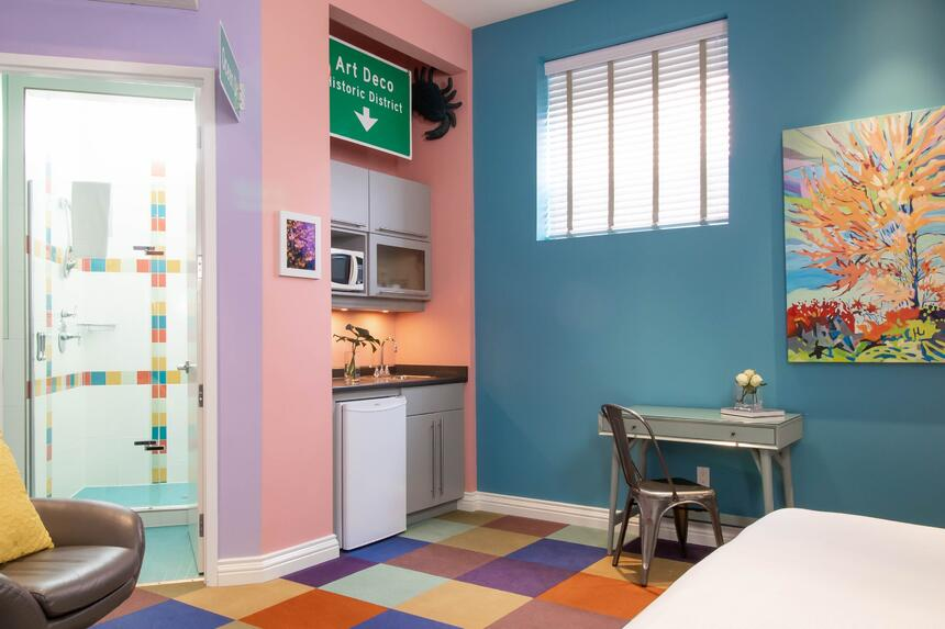 colourful space with area to work, bathroom and kitchenette in v