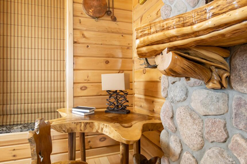 beautiful stone fireplace with decorative live edge wooden desk