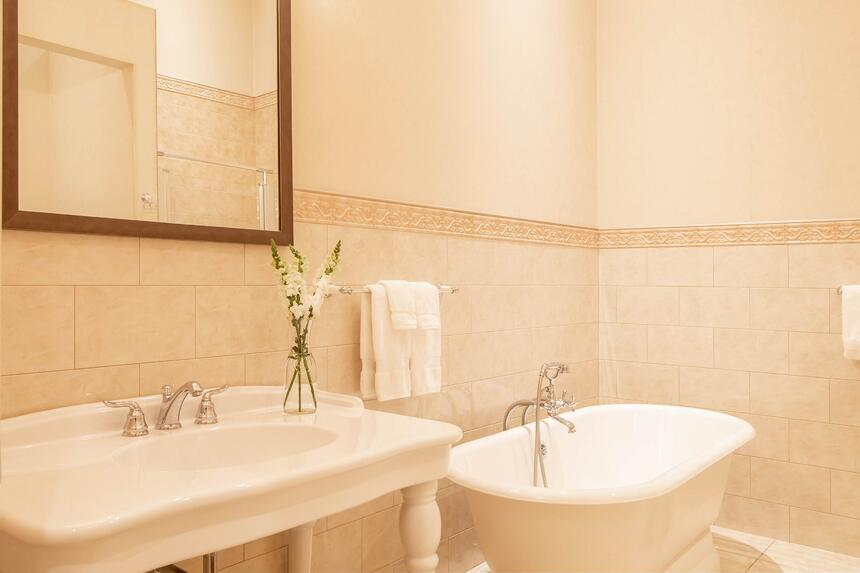 fully tiled bathroom with large relaxing soaker tub in king will