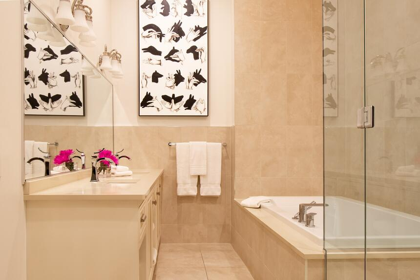 The bright bathroom from the presidential suite with large walk-