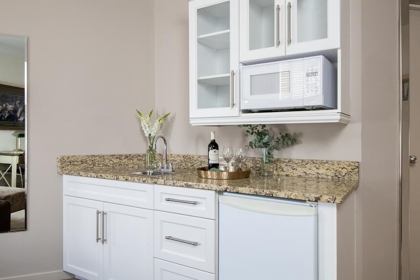 kitchenette with wine near the sink and microwave
