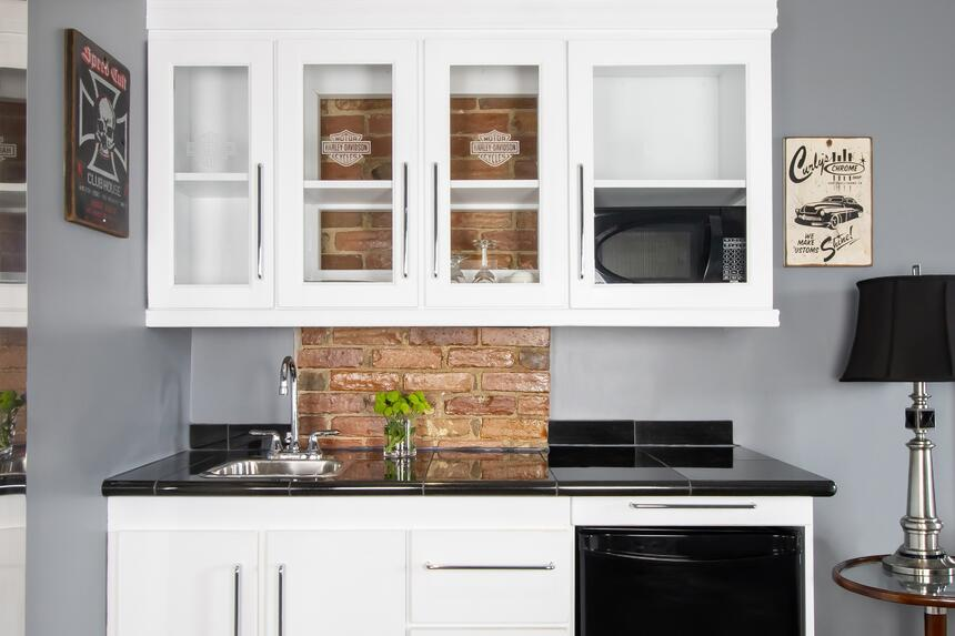 kitchenette in easy rider with exposed brick and motor cycle art