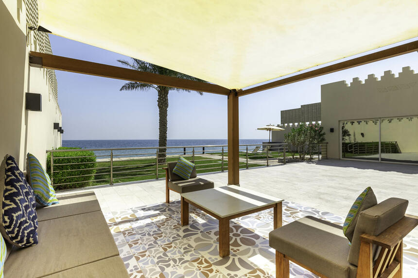 private garden area with pavillion, comfortable chairs, seaview