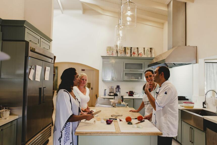 chef speaking to students in kitchen