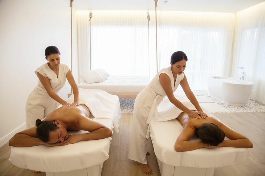 couple getting massage in spa room