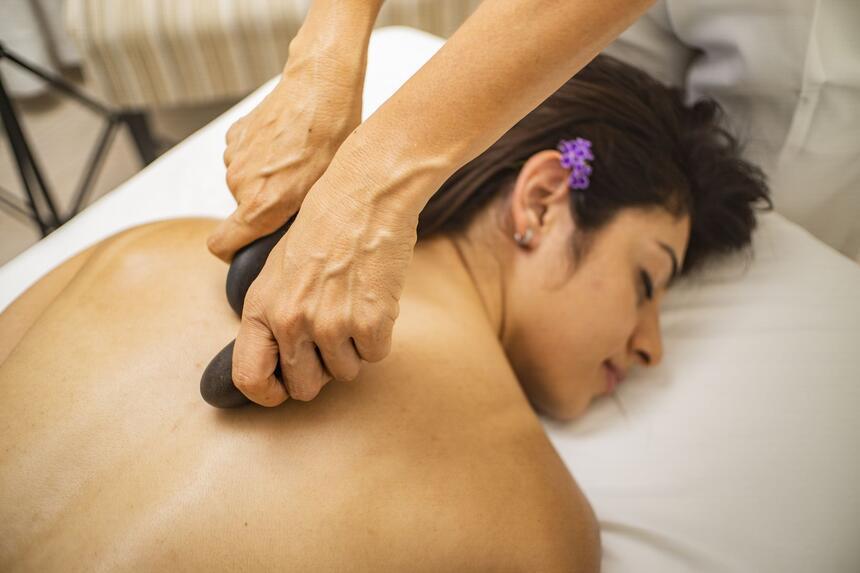 woman getting stone massage
