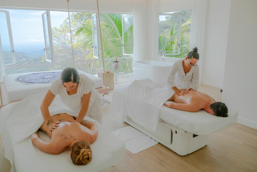 couple being massaged in spa room