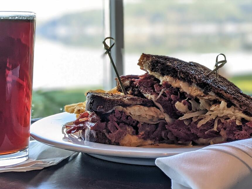 A sandwich dish served with a drink at Alderbrook Resort & Spa