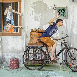 A penang mural of brother and sister who wants bao