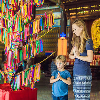 Tourists are praying in a Buddhist temple in penang