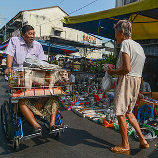 penang locals are selling stuffs on the roadside