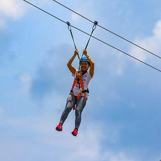 girl doing flying fox activity