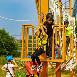 Kid doing flying fox activity in recreation park