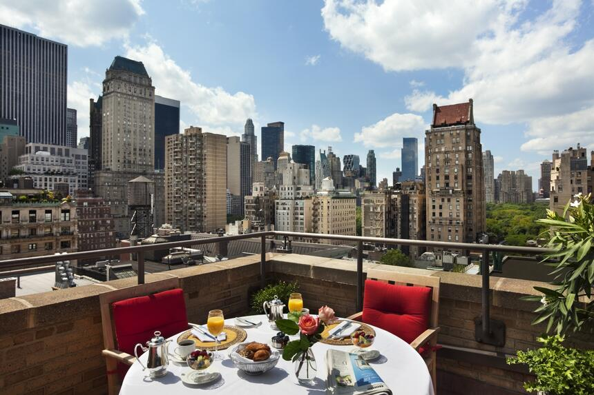 a table with breakfast on a balcony in New York City