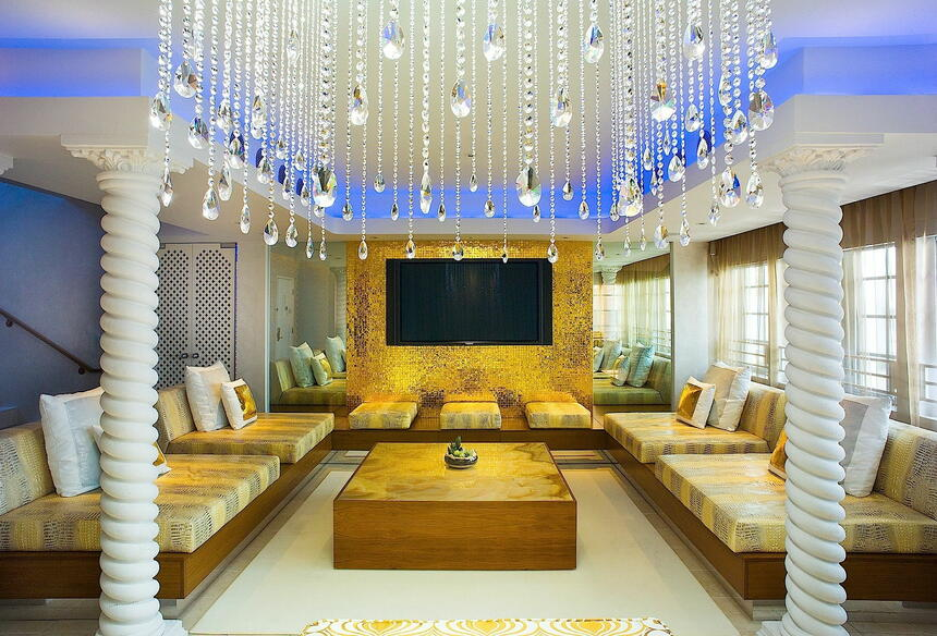 Chandelier light with sofa at sun house at Dream South Beach