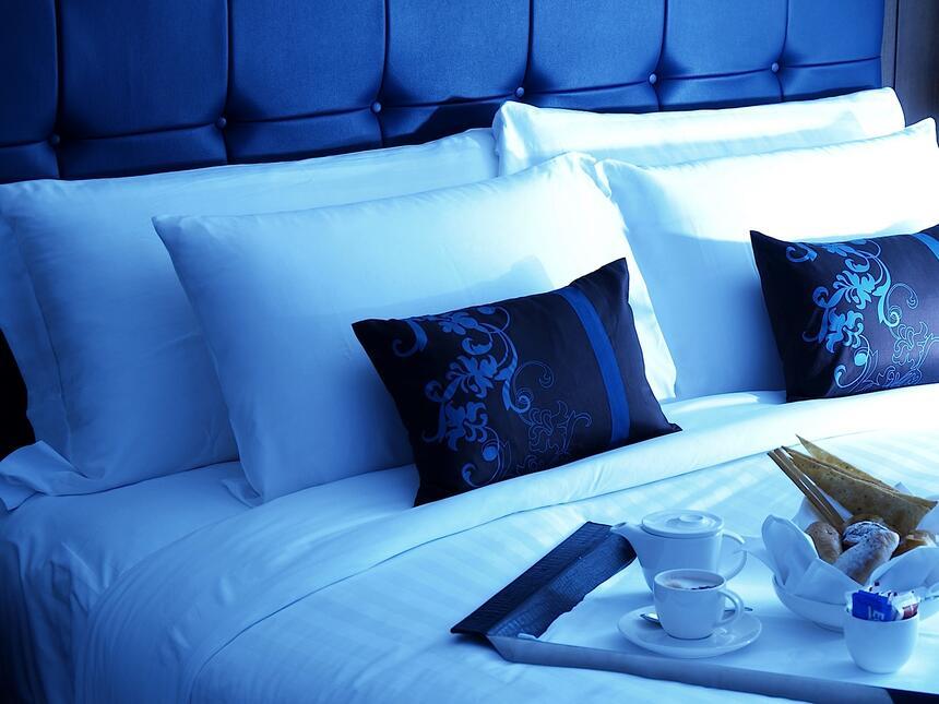 Dream bedding bed on a arranged tea set at Dream Bangkok