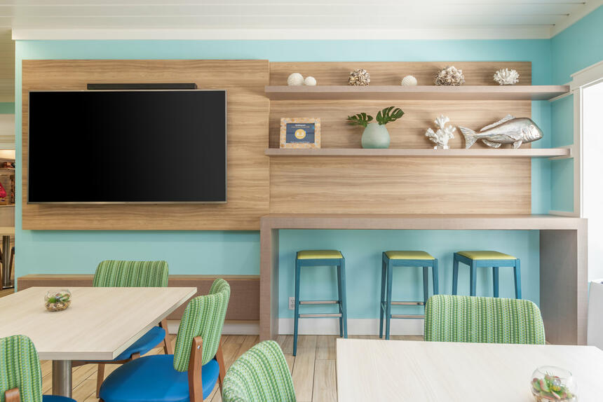 Interior view of dining area with tv at Palmera Inn and Suites