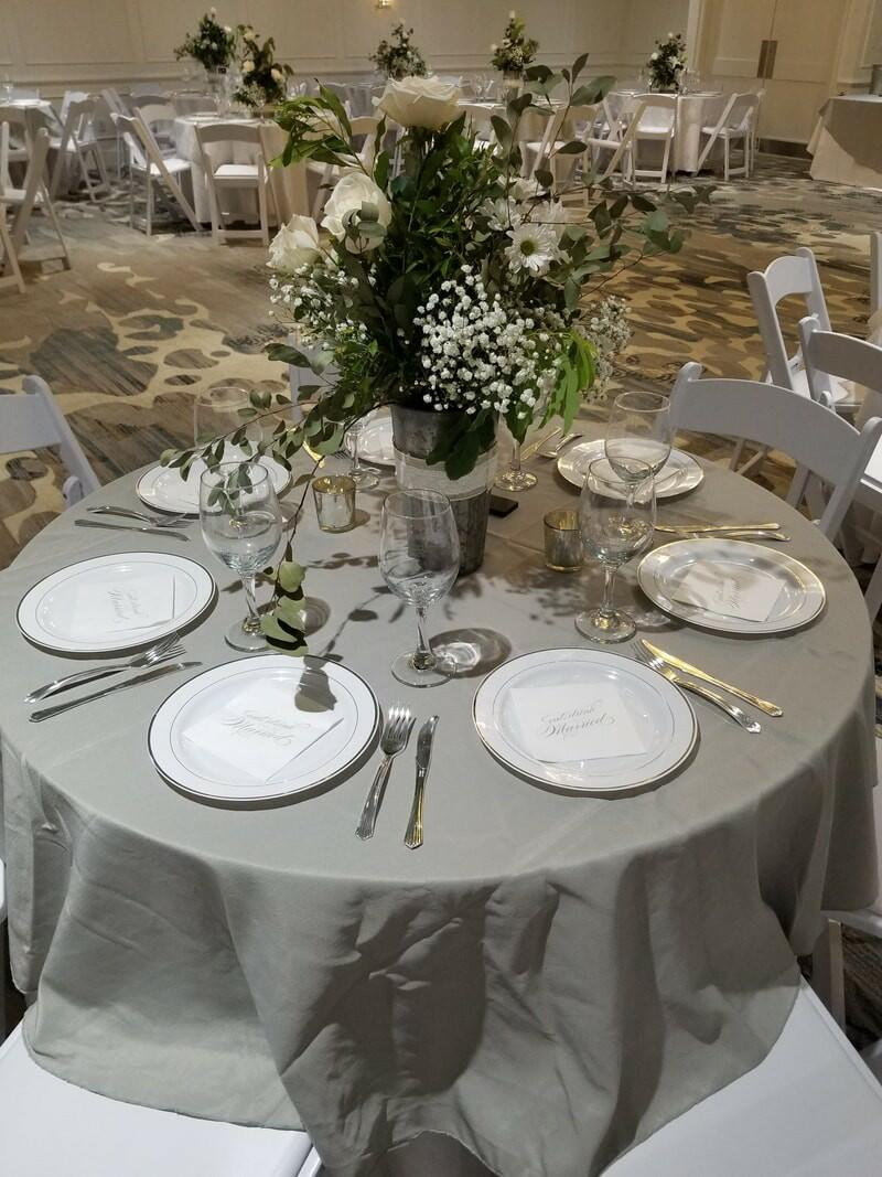 Banquet table arranged with plates at Palmera Inn and Suites