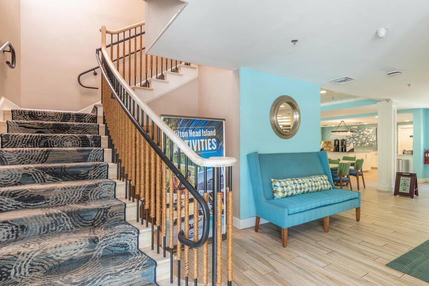 Living room with grand staircase at Palmera Inn and Suites