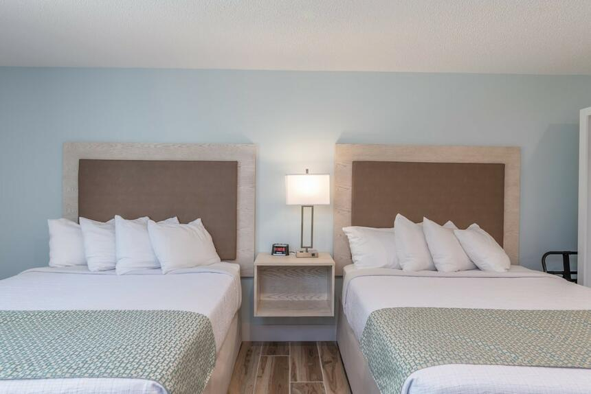 Twins beds in Double Queen Suite at Palmera Inn and Suites