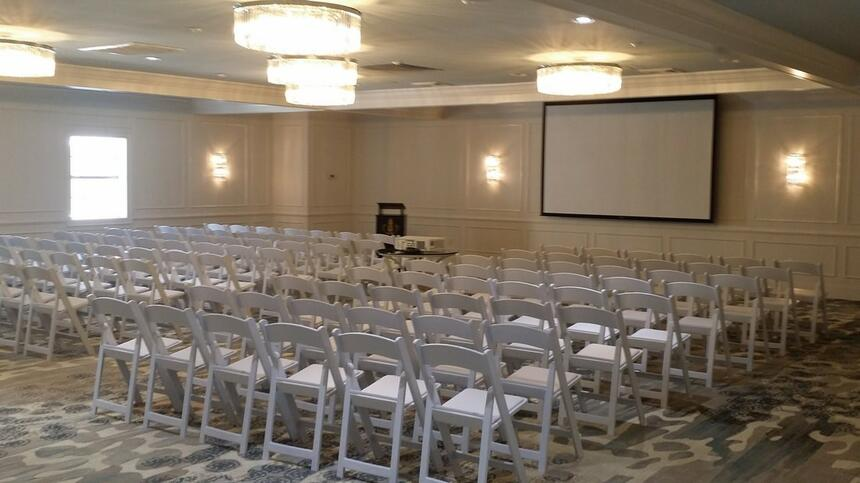 Arranged Crystal Hall with chairs at Palmera Inn and Suites