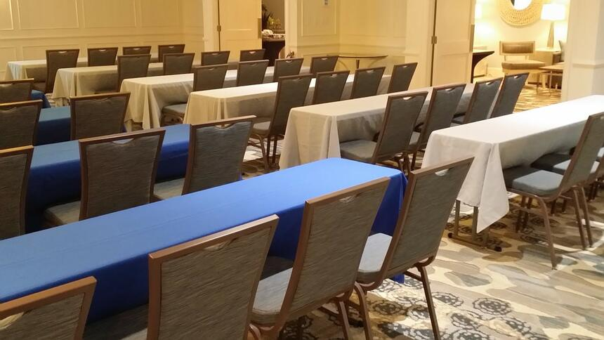 Meeting room with tables and chairs at Palmera Inn and Suites