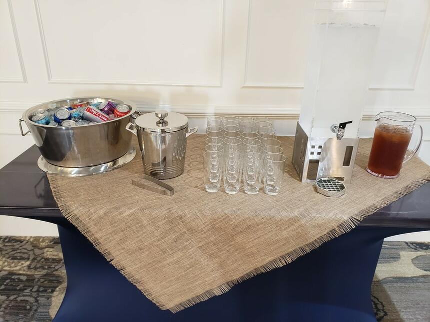 Table with coffee machine, glasses at Palmera Inn and Suites