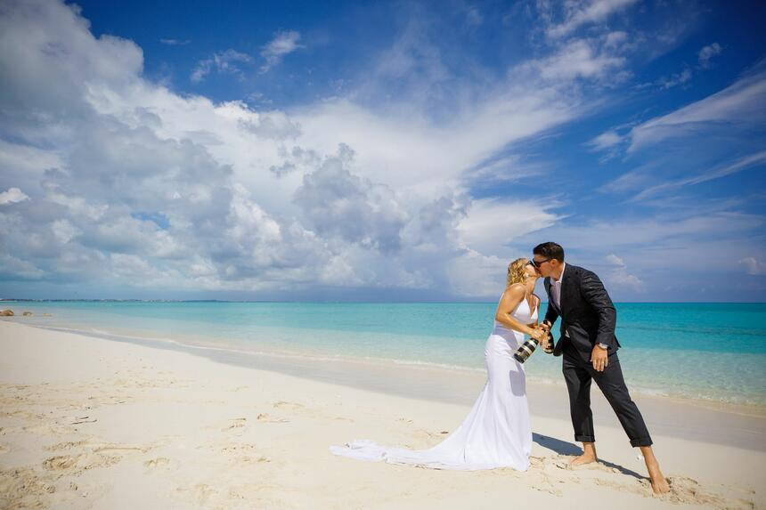 Wedding couple kissing at the beach at Somerset On Grace Bay