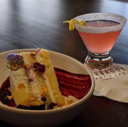 Slice of Lemon Huckleberry Cake and a drink served at Resort