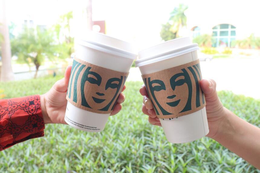 two Starbucks coffee cups