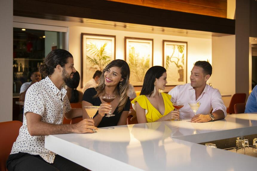 group sitting at bar with drinks